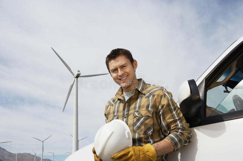 Engineer By Car At Wind Farm royalty free stock photography