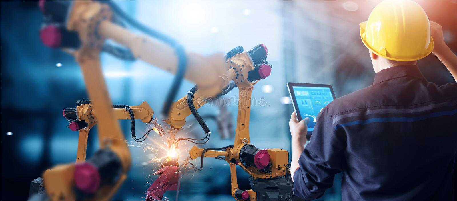 Engineer check and control welding robotics automatic arms machine in intelligent factory automotive industrial with monitoring sy. Stem software. Digital stock images