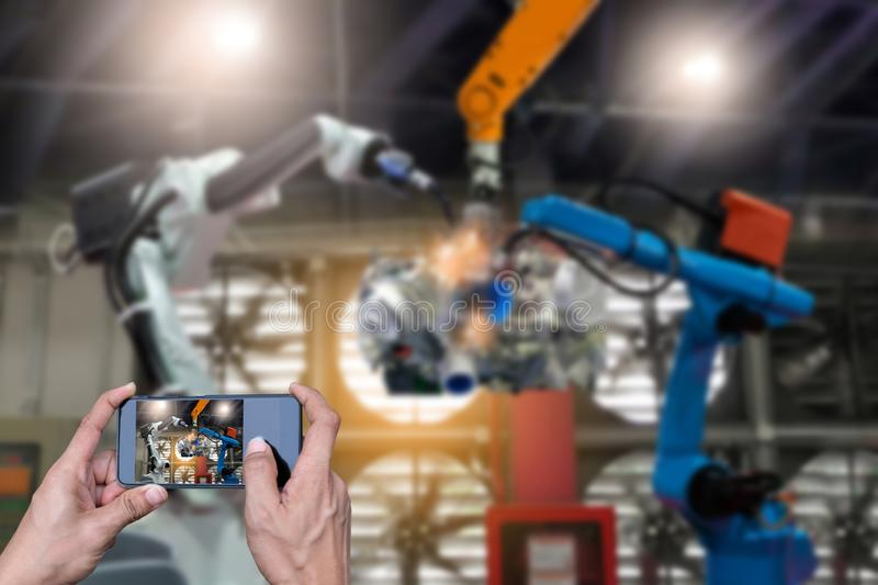 Engineer check hands hold smart phones monitoring system software control technology industrial stock photography
