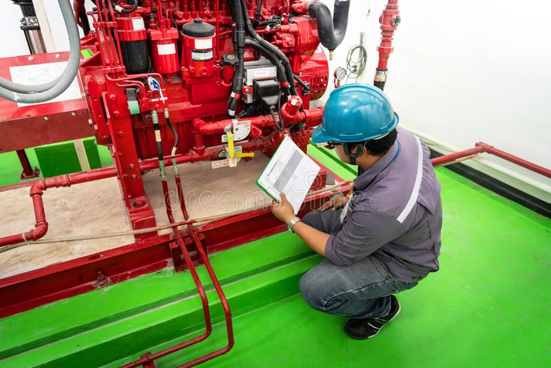 Engineer checking industrial generator fire control system. Diesel engine fire pump controller royalty free stock images