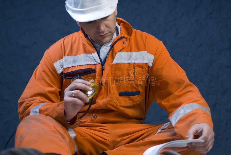 Engineer checking the plans stock images