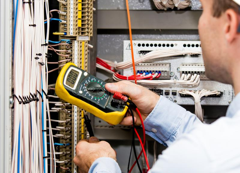 Engineer checking power supply royalty free stock photos