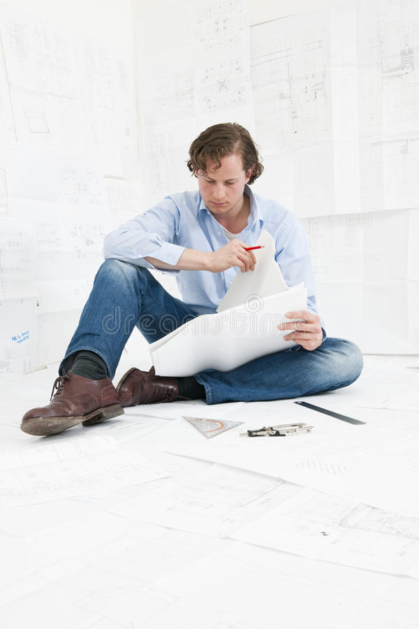 Engineer checking technical drawings stock photography