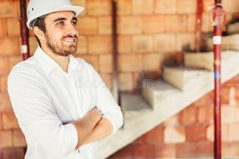 engineer checking work and smiling in the construction site royalty free stock images