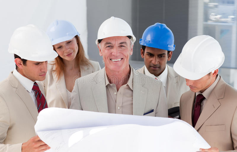 Download Engineer Co-workers Discussing A Project Stock Photo - Image of contractor, architect: 12054154