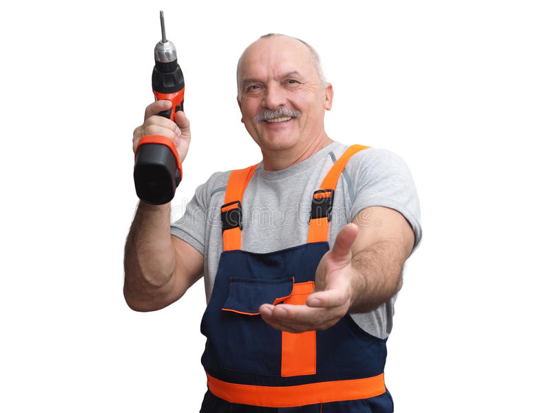 The engineer in construction pants holding trammel. The senior worker in jumpsuit holding screwdriver and outstretched to greet hand royalty free stock photo