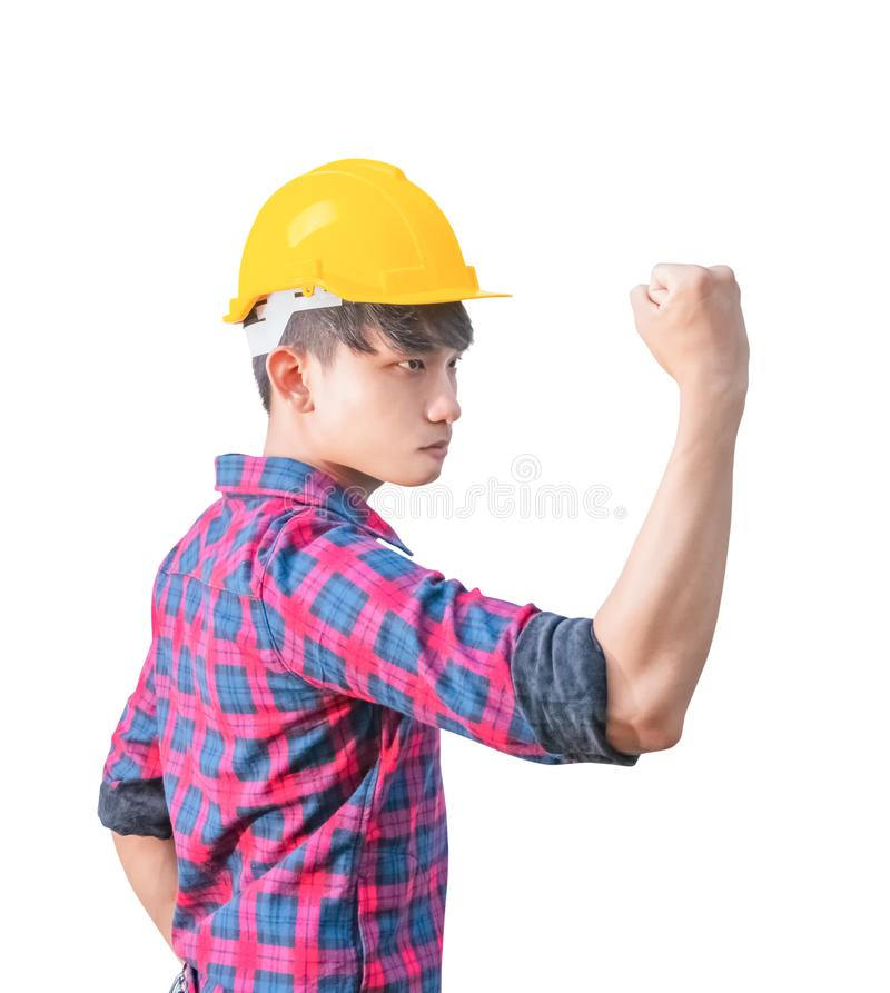 Engineer construction raise fist hand happy success that wear yellow safety helmet plastic isolated on white background.  royalty free stock photo