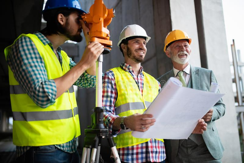 Engineer and construction site manager dealing with blueprints and plans stock images