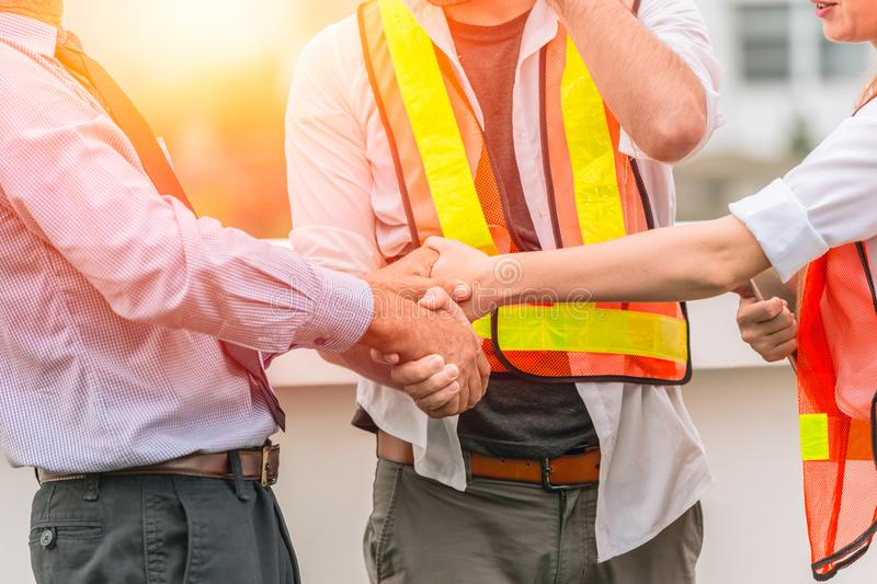 Engineer Constructor Teamwork Handshaking deal project together. With business investor man good relationship concept royalty free stock photos
