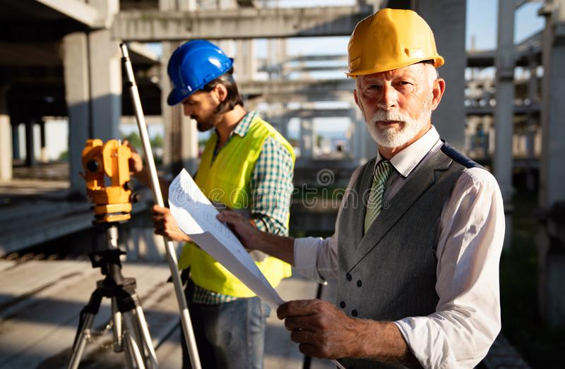 Engineer, contractor, architect teamwork. Construction people talking and planning work, blueprint stock photos