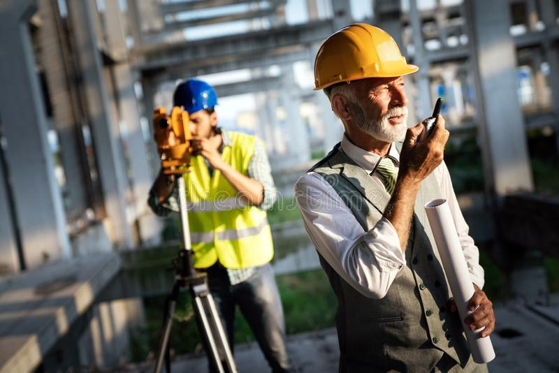 Engineer, contractor, architect teamwork. Construction people talking and planning work, blueprint royalty free stock photos
