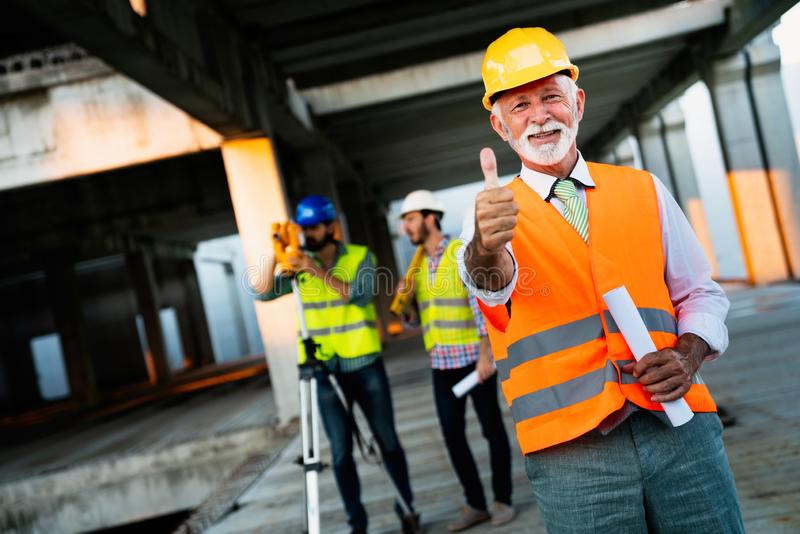 Engineer, contractor, architect teamwork. Construction people talking and planning work, blueprint royalty free stock images