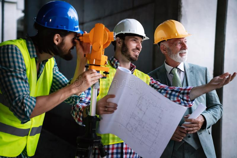 Engineer, contractor, architect teamwork. Construction people talking and planning work, blueprint stock images