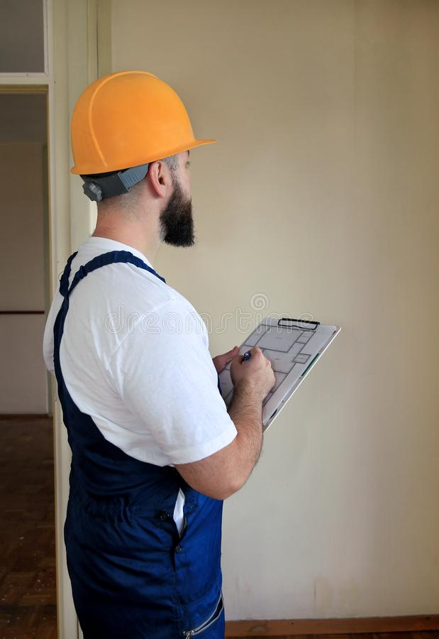 Engineer, contractor or project manager with documents construction is checking construction site. Apartment blueprint. royalty free stock photography