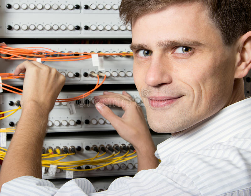 The engineer in a data processing center of ISP. Internet Service Provider hold fiber patch cords stock image