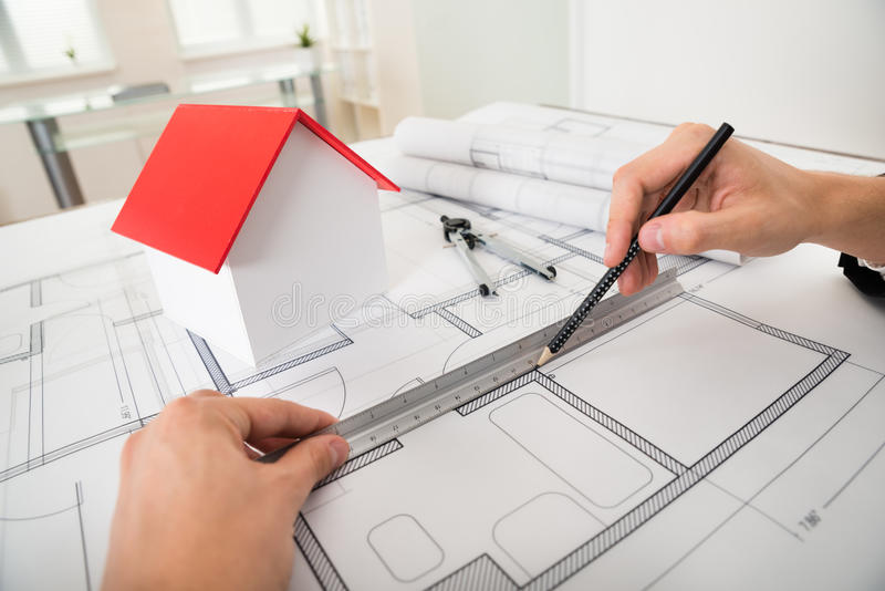 Engineer drawing diagrams on blueprint stock photo image of design download engineer drawing diagrams on blueprint stock photo image of design builder 58875670 ccuart Gallery