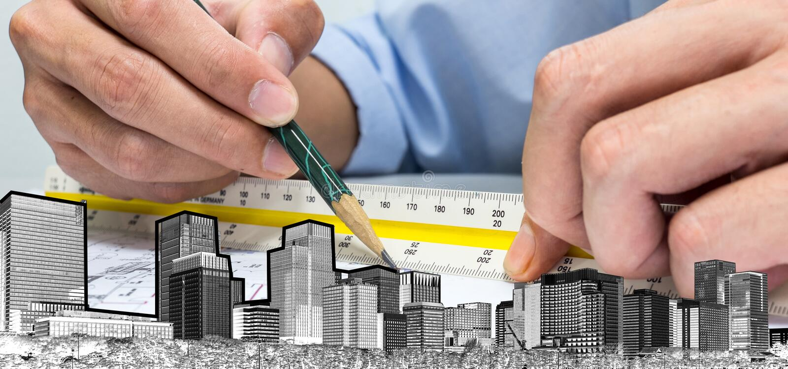 Engineer and drawing paper building whole world stock photo
