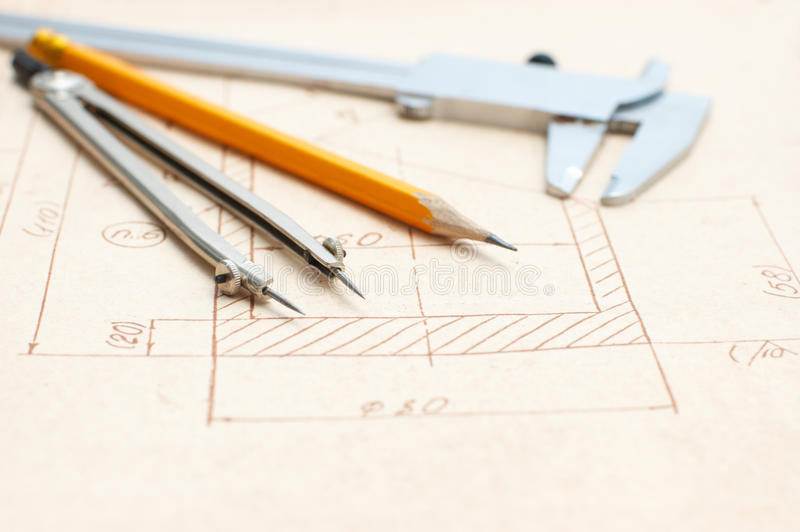 Engineer drawing and tools royalty free stock photos