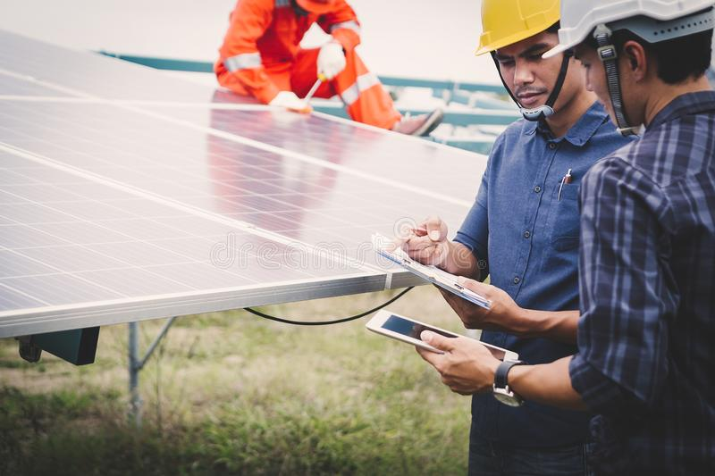 Engineer or electrician holding laptop for inspect and checking main distribution board by wifi technology ;smart technology for royalty free stock images