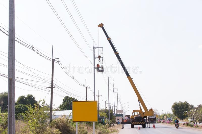 Engineer Electrician Workers On Repairing electrician work installation of high voltage in high voltage stations safely stock images