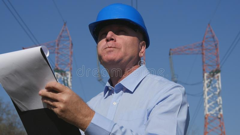 Engineer Electrician Working in Breakfast Time Eat and Read in Agenda. royalty free stock image