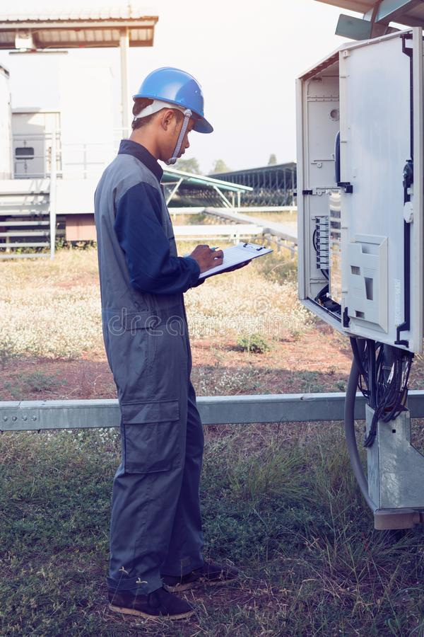Engineer or electrician working on checking and maintenance equi royalty free stock photos