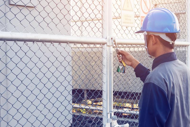 engineer or electrician working on checking and maintenance equipment at green energy solar power plant; checking status step up royalty free stock image