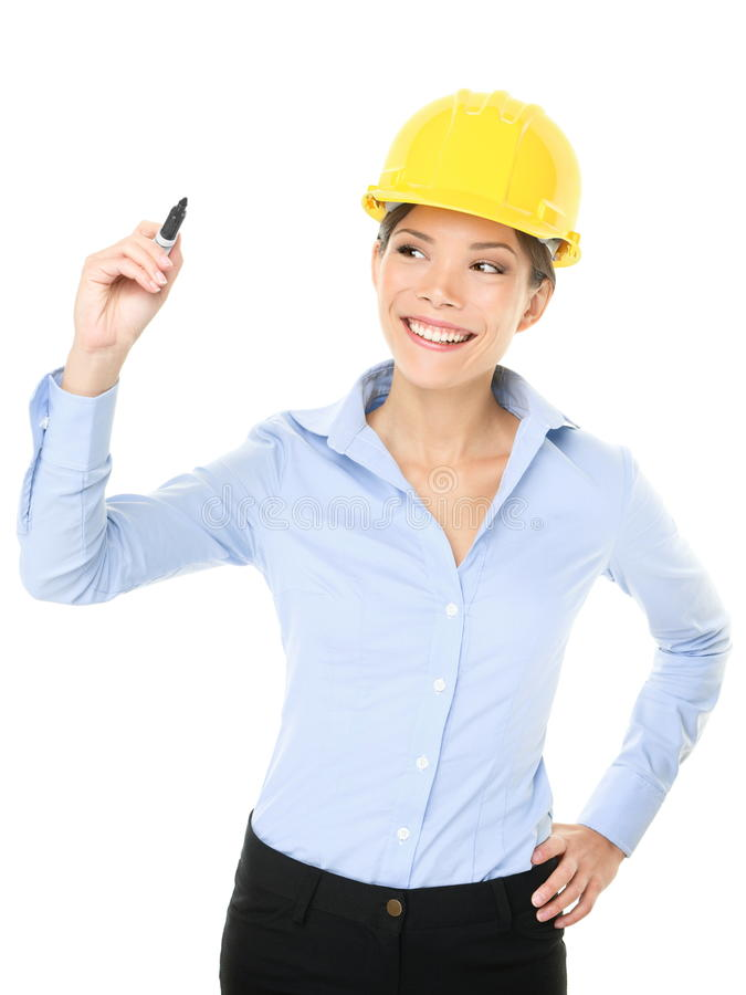 Engineer entrepreneur architect writing with pen. Engineer entrepreneur architect woman writing with pen showing copy space for your text or design. Young mixed stock image
