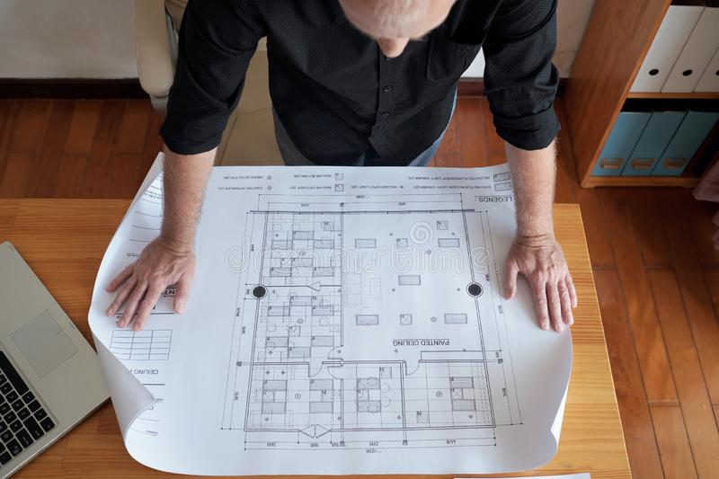 Engineer Examining Construction Plan stock images