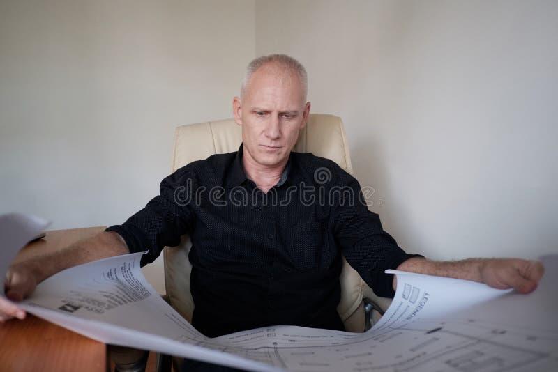 Engineer Examining Plan stock images