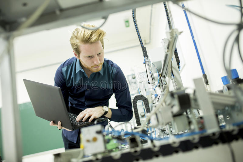 Engineer in the factory. Engineer working in the lab of the factory stock photos