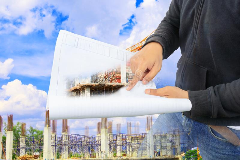 Engineer finger point on paper plan blueprint in check building technician place construction site royalty free stock images