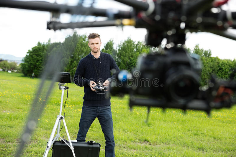 Engineer Flying UAV Helicopter in Park royalty free stock photography