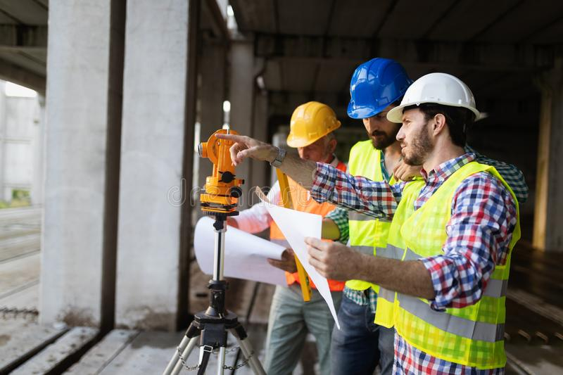 Engineer, foreman and worker discussing in building construction site royalty free stock photos