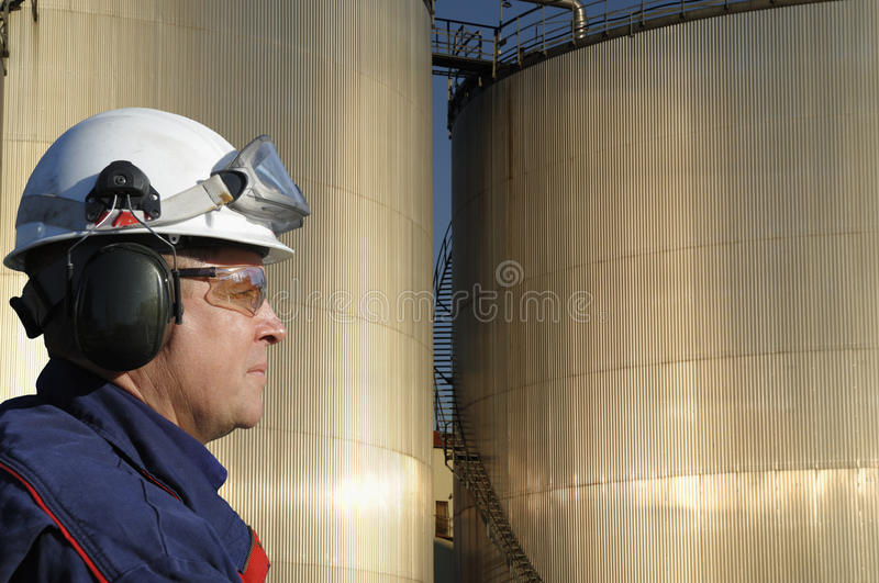 Download Engineer with fuel towers stock image. Image of industrial - 22666221