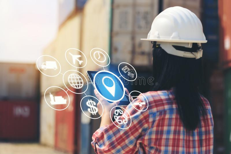 Engineer hand holding digital tablet with hologram on front container and import export background, Technology and Business royalty free illustration