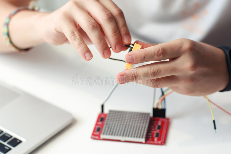 Engineer hands connecting electronic components stock images