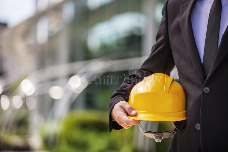 Engineer. Engineer holding protective helmet closeup shot royalty free stock images