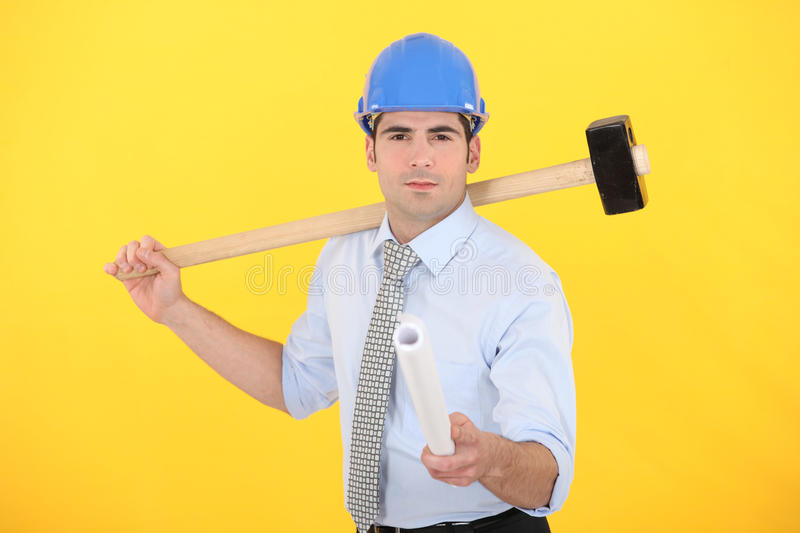 Download Engineer Holding A Rolled-up Blueprint Stock Image - Image: 26946321