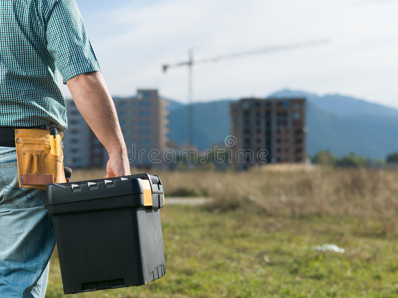 Engineer holding tool box stock images