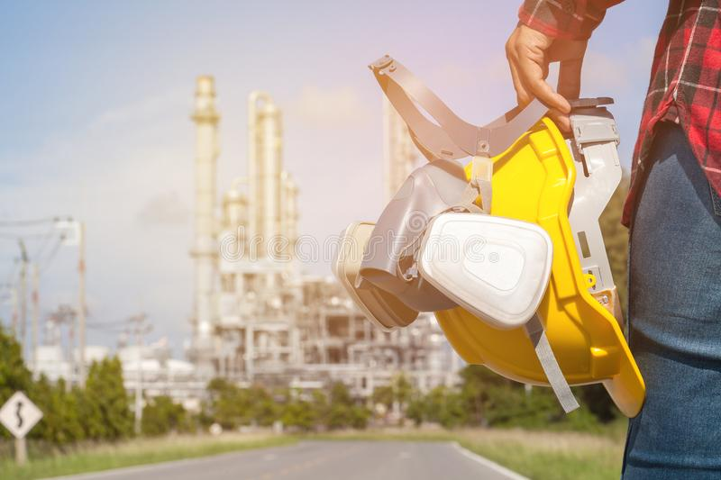Engineer holding a yellow helmet. For the safety of workers stock photo