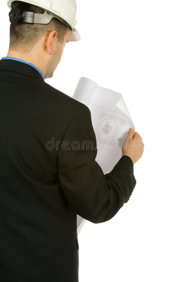 Engineer inspecting a drawing royalty free stock photo