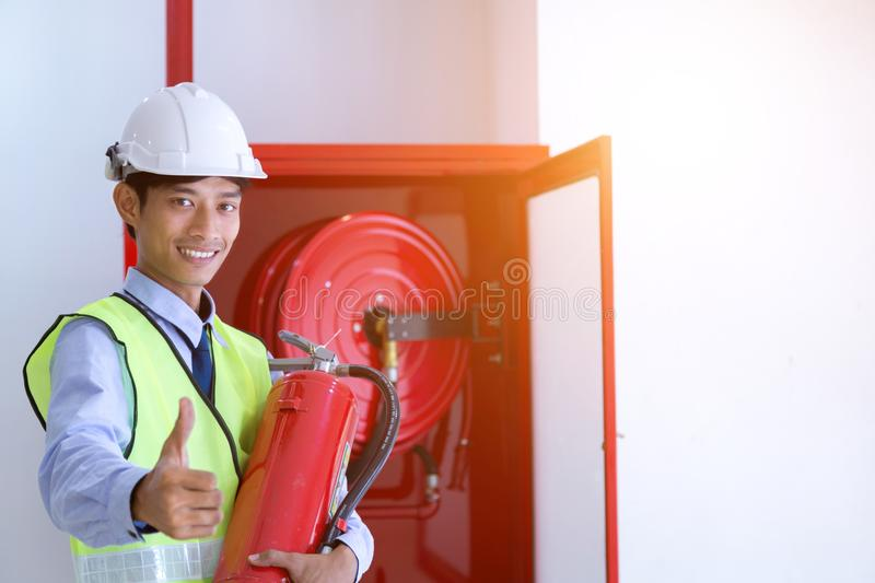 Engineer inspection Fire extinguisher and fire hose. stock photography