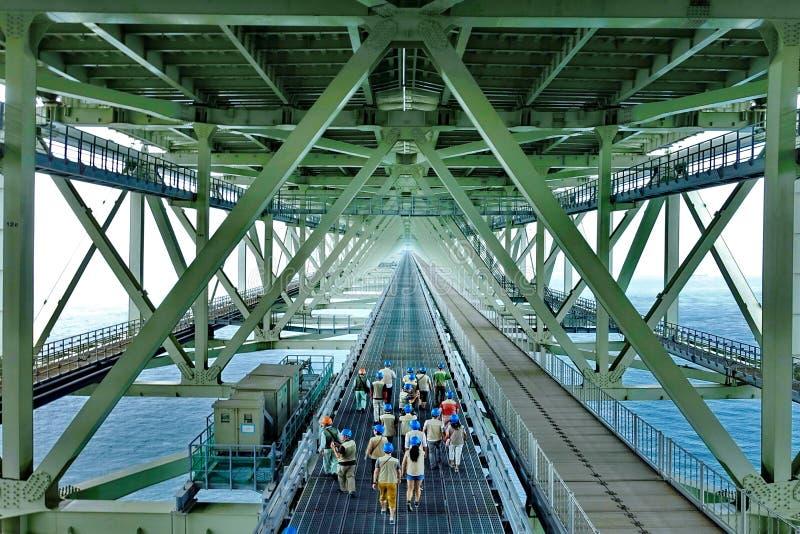 Engineer lead tourist to visit bridge. royalty free stock photography