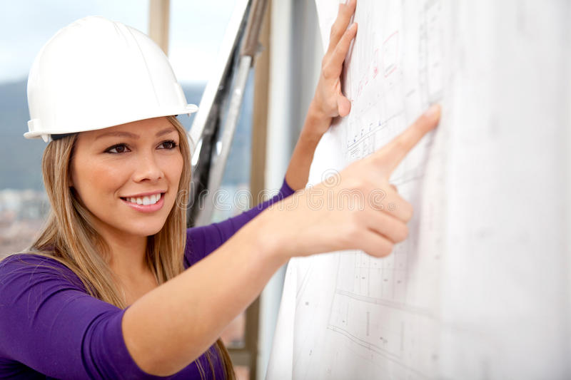 Download Engineer Looking At Blueprints Stock Photo - Image: 24792842