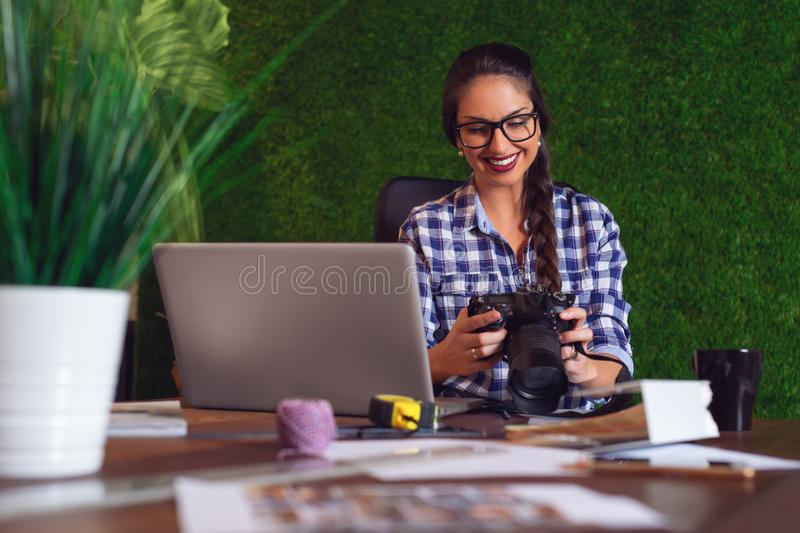 Engineer looking at photos that she took on camera that morning stock photos