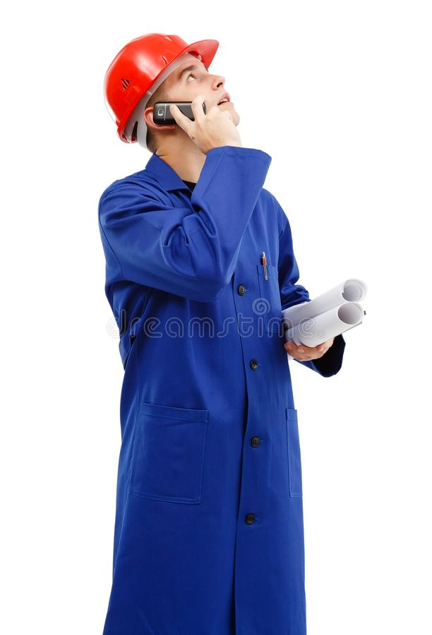 Engineer looking up while talking on the phone royalty free stock photos