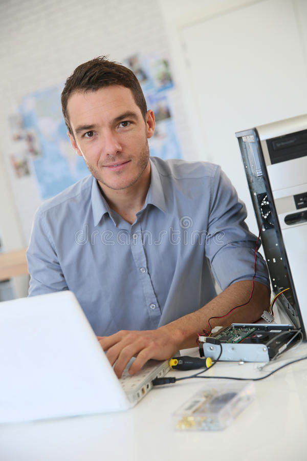 Engineer making data recovery fron hard disc drive. Engineer proceeding to data recovery from computer stock photo