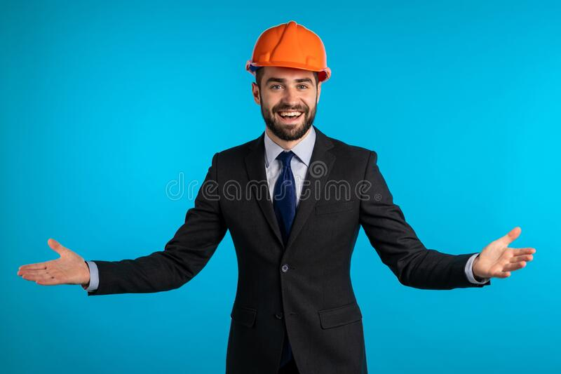 Engineer Man with beard in corporative suit over blue background. stock images