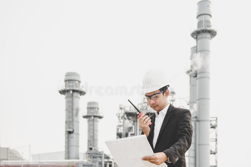 Engineer man holding white helmet and blueprint royalty free stock photography